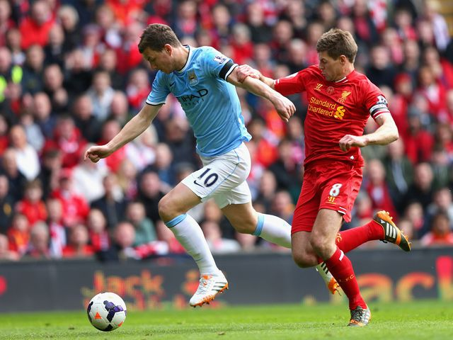 Edin Dzeko is put under pressure by Steven Gerrard