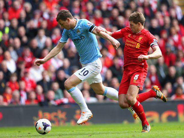 Edin Dzeko is put under pressure by Steven Gerrard