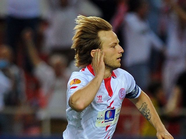 Ivan Rakitic celebrates for Sevilla