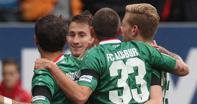 Augsburg celebrate their opening goal