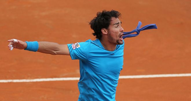 Fabio Fognini celebrates his victory over Andy Murray that levelled the tie at 2-2