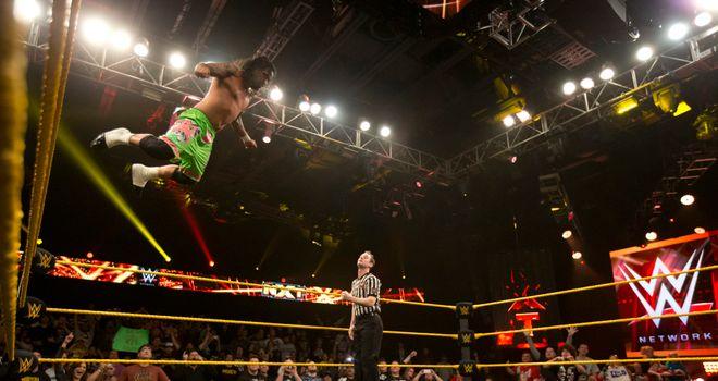 Jey Uso leaps onto the stricken Corey Graves