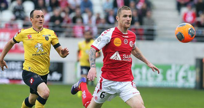 Reims' Antoine Devaux vies with Sochaux's Sebastien Roudet