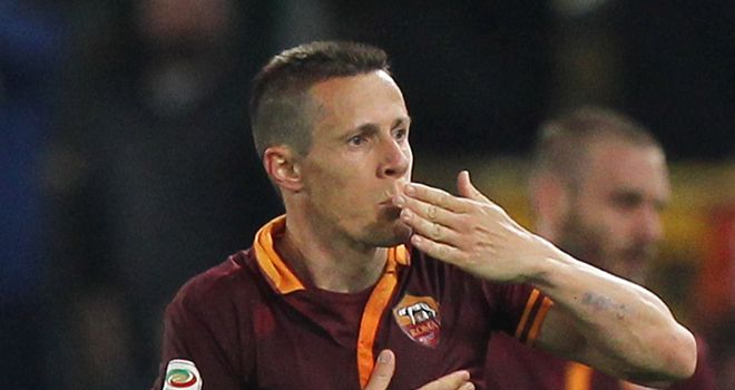 Rodrigo Taddei celebrates scoring for Roma
