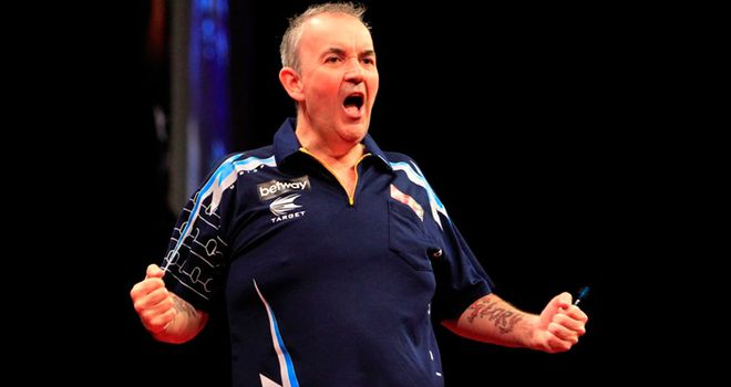 Phil Taylor: Doubling up, along with opponent Dave Chisnall, in Birmingham
