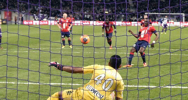 Salomon Kalou scores from the penalty spot