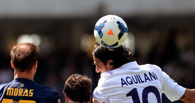 Alberto Aquilani wins a header