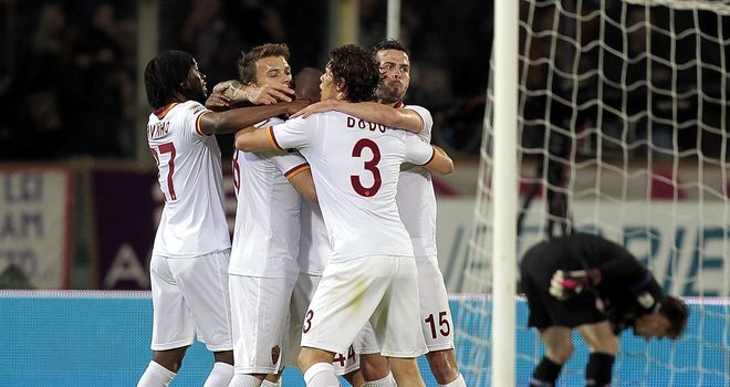 Roma players celebrate after the winning goal is scored