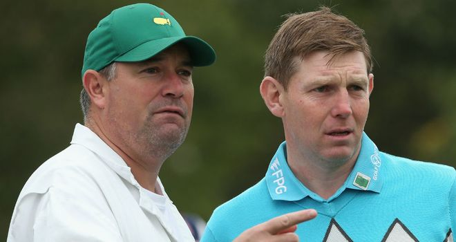 Stephen Gallacher of Scotland is pictured with his caddie Damian Moore during a practice round ahead of the 2014 Masters at Augusta National