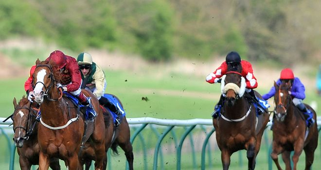 Pearl Secret (left), ridden by Jamie Spencer, on his way to victory at Nottingham