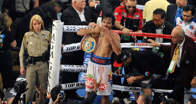 Manny Pacquiao: Celebrates after his victory over Timothy Bradley during their WBO world welterweight champion.