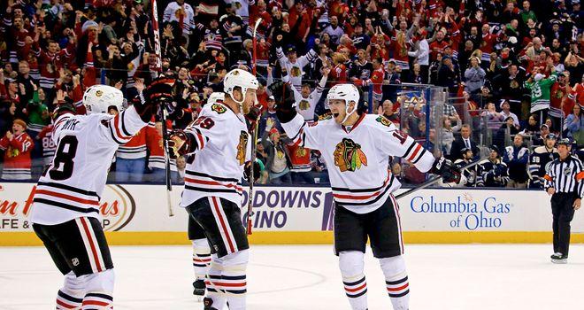 Ben Smith celebrates his game winner with his Chicago Blackhawks team-mates