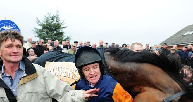 Barry Geraghty and Rebel Fitz enjoy a post-victory wrestle in the winner's enclosure.