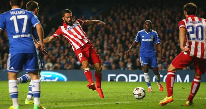Arda Turan taps in Atletico's third