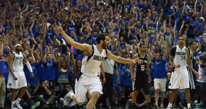Jose Calderon of the Dallas Mavericks celebrates after Vince Carter's game-winning shot
