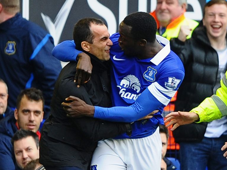 Romelu Lukaku celebrates with Roberto Martinez