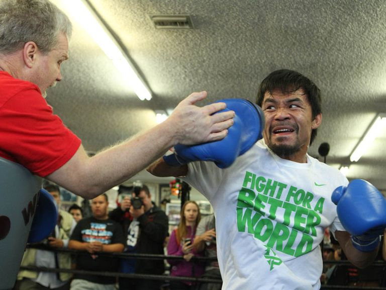 Manny Pacquiao works out with trainer Freddie Roach