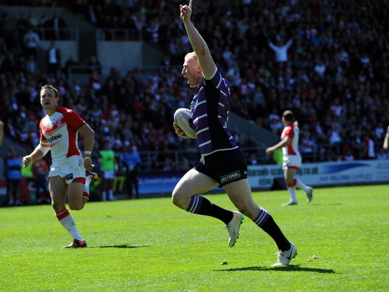 Liam Farrell celebrates scoring one of his tries
