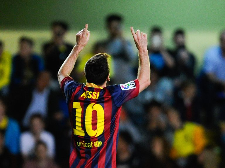 Lionel Messi celebrates after scoring his team's third goal on Sunday