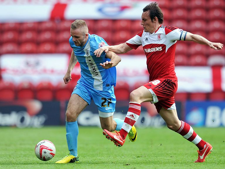 Dean Whitehead of Middlesbrough in action with Ryan McLaughlin of Barnsley