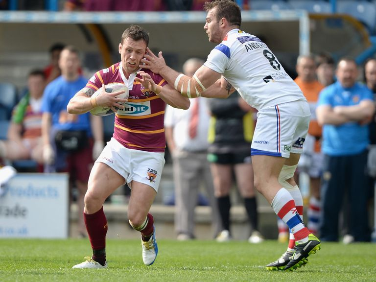 Shaun Lunt holds off Scott Anderson in the Huddersfield v Wakefield clash