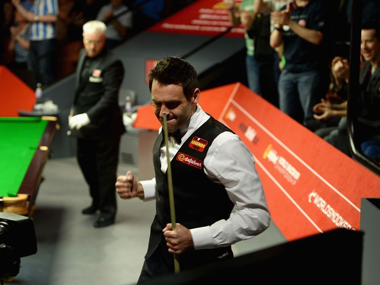Ronnie O'Sullivan celebrates beating Joe Perry