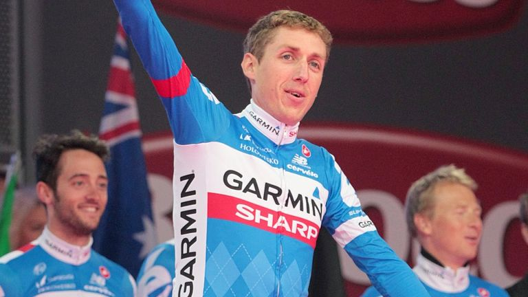 Dan Martin waves to thousands of fans at the Giro d'Italia team presentation in Belfast