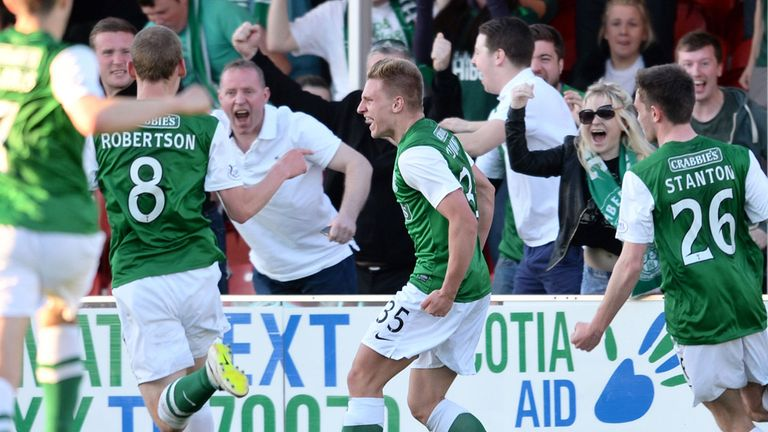 Jason Cummings (c) celebrates the first of his two goals