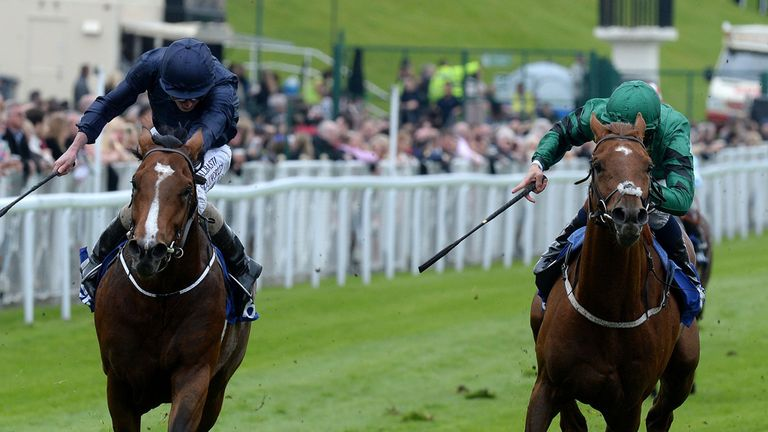 Orchestra (left) ridden by Ryan Moore wins the MBNA Chester Vase from Romsdal