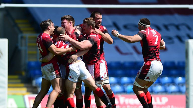 London Welsh players celebrate on the final whistle after clinching victory over Leeds Carnegie