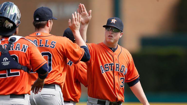 Matt Dominguez celebrates with his Houston Astros team-mates