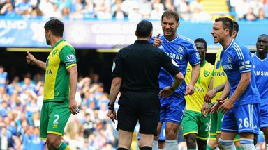 Referee Neil Swarbrick: Has a harsh word with Ivanovic