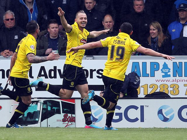 Adam McGurk celebrates the decisive goal for Burton