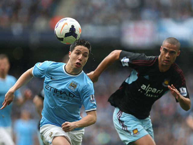 Samir Nasri and Winston Reid chase the ball