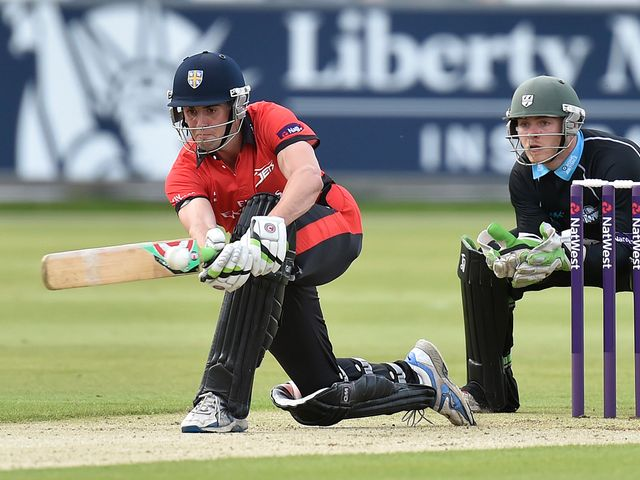 Durham's Calum MacLeod hits a four during the win over Worcestershire