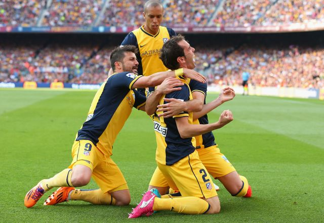 Diego Godin celebrates netting Atletico Madrid's equaliser