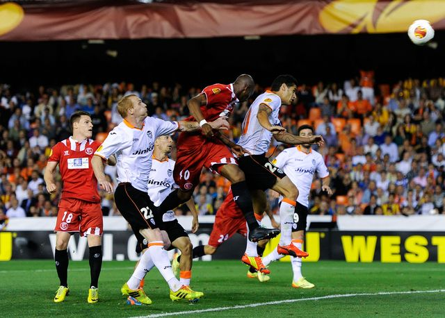 Stephane Mbia powers home his late header for Sevilla