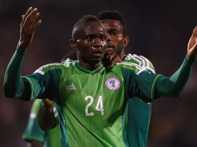 Uche Nwofor celebrates after scoring Nigeria's equaliser