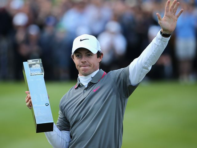 Rory McIlroy poses with the trophy