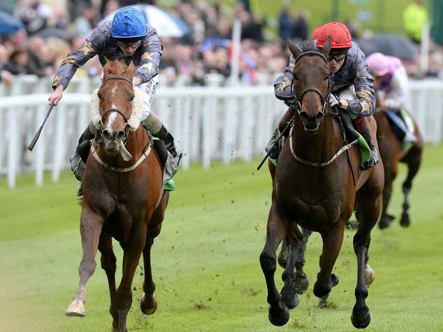 Suegio (left) ridden by Ryan Moore wins The StanJames.com Chester Cup, from Angel Gabrial.