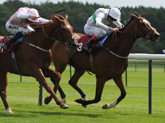 Sultanina ridden by William Buick (left) beats Freedom's Light at Haydock