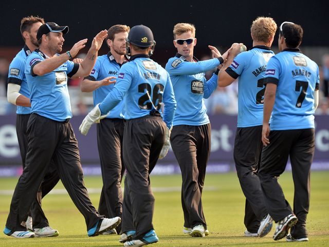 Sussex celebrate taking the wicket of Eoin Morgan