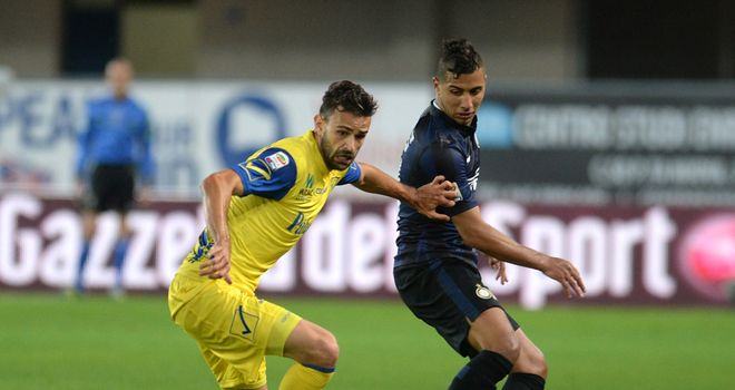 Ivan Radovanovic (left) of Chievo in action on Sunday