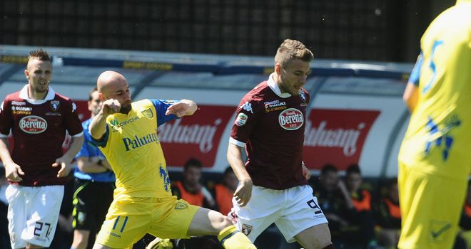 Ciro Immobile competes the ball with Roberto Guana