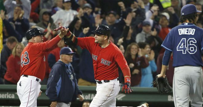 A.J. Pierzynski (centre) celebrates after his winning hit for the Boston Red Sox