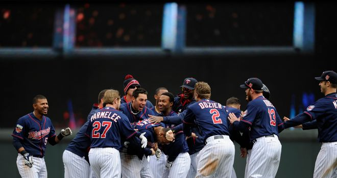 The Minnesota Twins mob Aaron Hicks after his late heroics