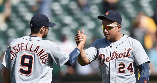 Miguel Cabrera and Nick Castellanos celebrate defeating the Oakland Athletics