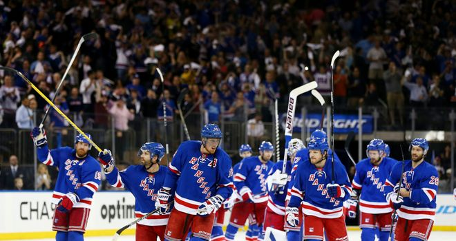 The New York Rangers celebrate their 3-1 win over the Pittsburgh Penguins