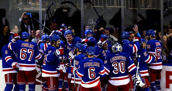 The New York Rangers celebrate after Martin St Louis scored in overtime