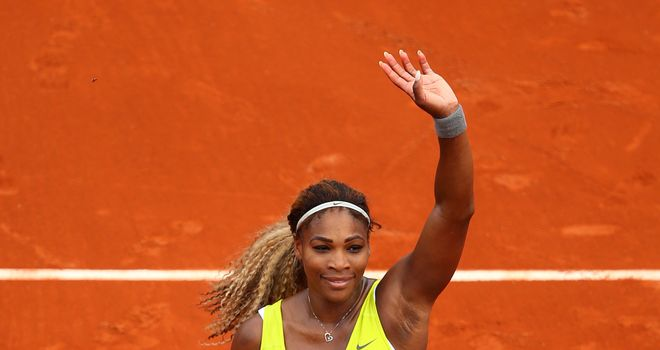 Defending champion Serena Williams celebrates victory over Alize Lim on day one of the French Open